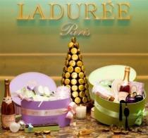 Cappelliera per il tavolo delle bomboniere con prodotti di Boutique Ladurée