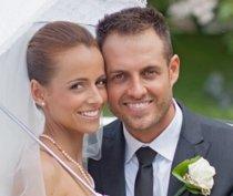 Sposi durante il giorno del matrimonio con un sorriso perfetto curato da Sorriso da Sposa