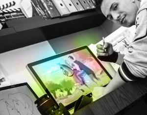 Il fotografo mentre disegna i personaggi del video di matrimonio