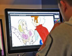 Il fotografo mentre colora i personaggi del video di matrimonio