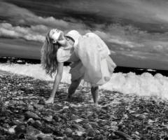 Fotografia della sposa in riva al mare