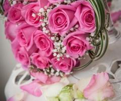 Foto del bouquet e delle fedi nuziali