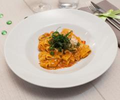 La cucina: un primo piatto Al Chiar di Luna