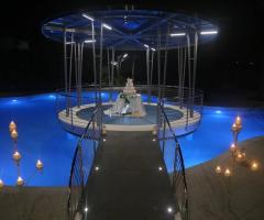 Villa Reale Ricevimenti - L'incantevole momento del torta presso L'oasi di Cupido
