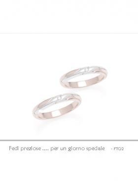 Ro.An. - Coppia fedi in oro bianco e rosa.