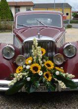 Addobbi floreali con girasoli per la macchina da cerimonia