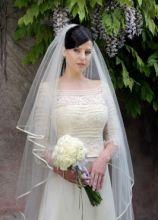 Abito da sposa con velo