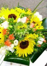 Bouquet di girasoli e rose per la sposa