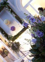 Addobbi floreali in lilla per il ricevimento di nozze