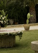 Fiori e addobbi con candele per il matrimonio a Cisternino