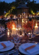 Centrotavola con candele e orchidee mokara