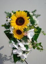 Bouquet cadente di girasoli e orchidee Phaleno