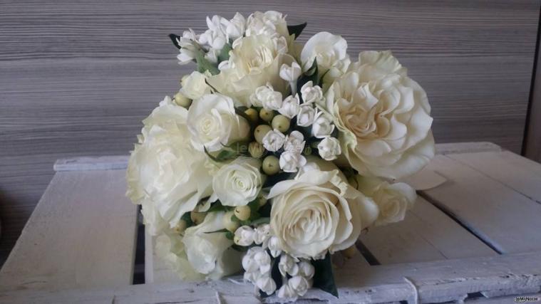 Insolito Fiori - Centrotavolo per il ricevimento di nozze