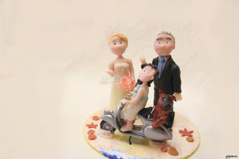 Sposi per torta con vespa bambina e cane barbara for Puntura vespa cane