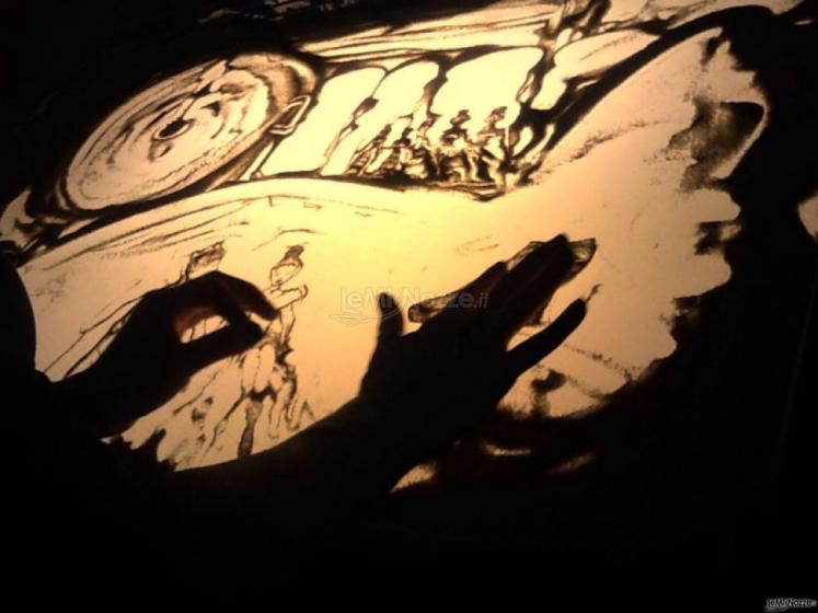 Spettacoli emozionanti di sabbia animata - La composizione delle immagini